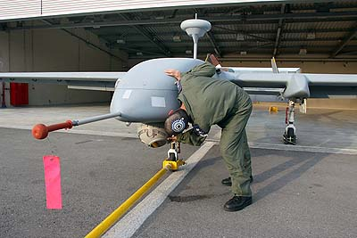 Air Force chief Ido Nehushtan checking an unmanned aircraft. Jihadists say they won't cease fire until Israel stops targeted killings which often utilize drones.