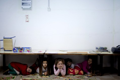 Israeli children taking cover during rocket attack