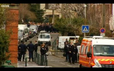 Outside the Toulouse Jewish school where Islamists murdered a rabbi and two of his children last March.