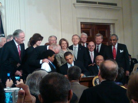 President Obama signing health care bill into law