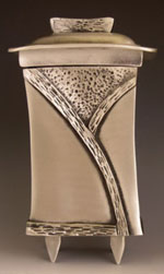 Aimee Golant. Justice Tzedakah Box. 8 x 4.25 x 3.5 inches. Silver and tin alloy.