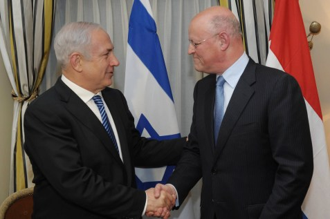 Dutch Foreign Affairs Minister Uri Rosenthal welcomes Israel's Prime Minister Benjamin Netanyahu prior to their meeting in The Hague, Netherlands.