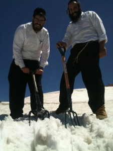 Rabbis collecting snow for the Metulla mikvah