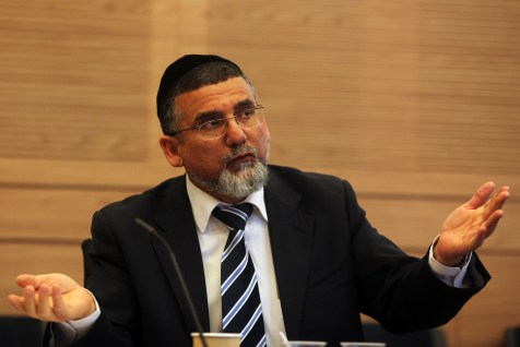 Knesset member Yitzhak Vaknin of Shas party speaks at the Finance committee in the Knesset in Jerusalem.