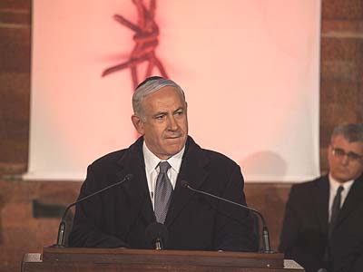 Israel's Prime Minister Benjamin Netanyahu speaks at a ceremony at the Yad Vashem Holocaust Memorial Museum in Jerusalem, as Israel marks the annual Holocaust Remembrance Day.