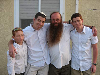 Moshe with their three sons.