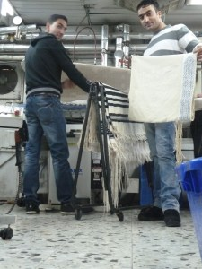 Arab dry cleaners prepare Jewish prayer shawls for the Holiday in Jerusalem.