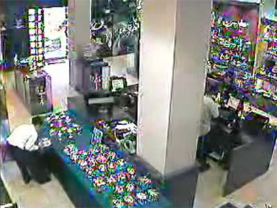 Shoplifter casually stuffing his bag with expensive Judaica item in a Jewelry store in B'nei B'rak.