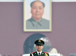 A Chinese guard in Tiananmen Square
