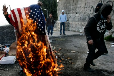 Palestinians burn an American flag in east Jerusalem
