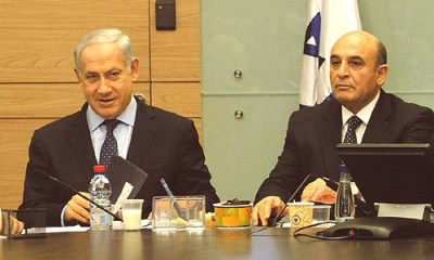 The two winners of last night's unprecedented maneuver, Prime Minister Benjamin Netanyahu (L) and his new deputy and coalition partner, former Defense Minister Shaul Mofaz.