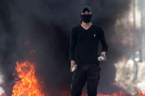 Palestinian stone-thrower taking a breather