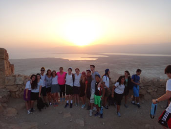 Hebrew Academy students enjoy a magnificent sunrise on Masada.