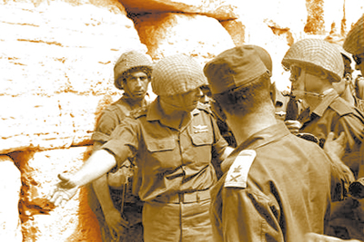 "IDF Chief of Staff Yitzhak Rabin ""invites"" Defense Minister Moshe Dayan to the Kotel, or Western Wall, which had just been liberated by Israeli troops during the 1967 Six-Day War. This Sunday is Yom Yerushalayim, the 45th anniversary of that milestone event in Jewish history."