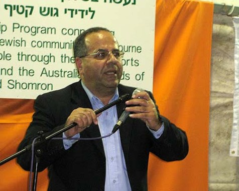 Druze Deputy Minister Ayoob Kara (seen here at a conference of Friends of Gush Katif in Samaria) is warning against the world's silence on Syrian massacres.