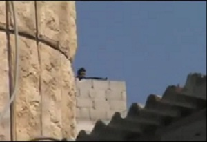 Syrian soldier shooting at protesters in the city of Hama