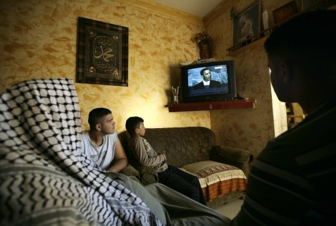 An Arab family watching US President Barack Obama speak