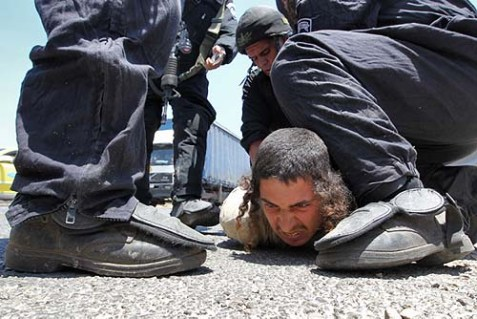 A settler being arrested last year by IDF and Border Guard forces last year.
