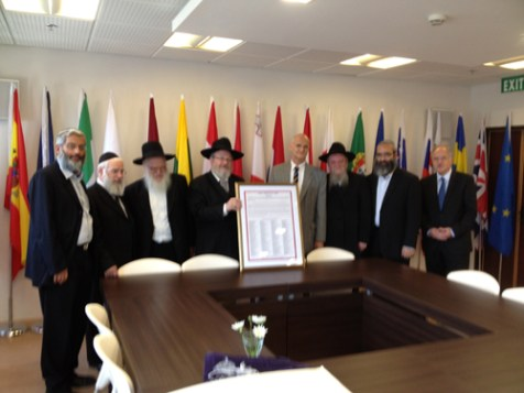RCP presenting EU Ambassador Andrew Standley with the Psak Halacha signed by over 350 rabbis stating that is forbidden to give up one inch of land.