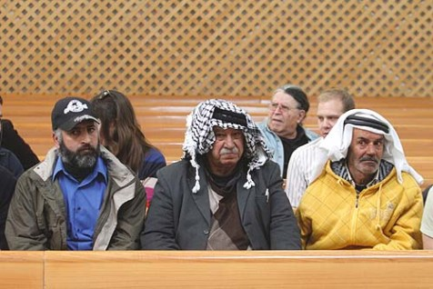 Arabs sit in the crowd at the High Court hearing were it debated the petition by the far left Peace Now group to immediately evict the residents of Migron from their homes.