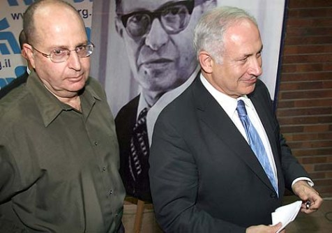 Deputy Prime Minister Moshe Ya&#039;alon (L) with Prime Minister Benjamin Netanyahu against the background image of a former Likud premier.