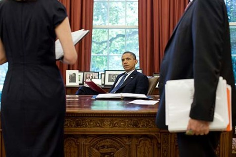 President Obama at his desk, secure in his status as &quot;natural born citizen.&quot;