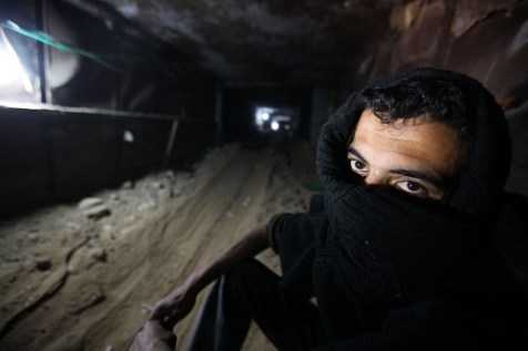 A Palestinian smuggler in a tunnel under the Egyptian-Gaza border