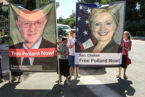 Protesters hold a poster of Secretary of State Hillary Clinton and former CIA director James Woolsey, demanding the release of longtime prisoner Jonathan Pollard.