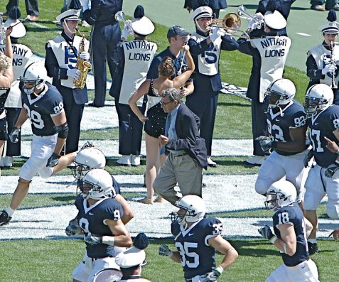 Joe Paterno running out with football team