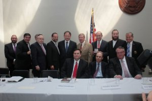 (L-R, standing) Ben Hoffman, board member (Lakewood); Jonathan Zalisky, Healthplus Amerigroup; Stanley Treitel, board member (LA); Leon Goldenberg, board member; Abe Biderman, board member; Senator Johnny Isakson; The Honorable Emil Fish, honoree; Ezra Friedlander, CEO Friedlander Group; Andrew Friedman, esq., luncheon co-chairman/LA fire commissioner. (L-R, sitting) Sidney Greenberger, Ken Abramowitz, Peter Rebenwurzel, board members.