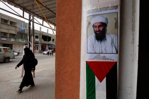 A picture of former al Qaeda leader Osama bin Laden above a Palestinian flag