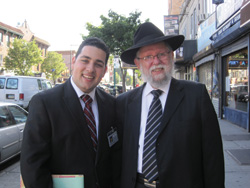 Avraham Tischler petitioning on Ave. J with a petition signer.