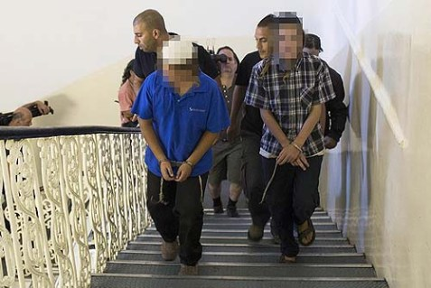 Two of the three young boys from Bat Ayin suspected of an August 16 firebombing of an Arab taxi being led to a hearing at the Magistrates court in Jerusalem on Sunday.