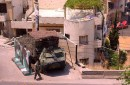 Lebanese army vehicle and soldier on Syria Street, guarding the border between Bab al-Tabbaneh and Jabal Mohsen neighborhoods of Tripoli, Lebanon.
