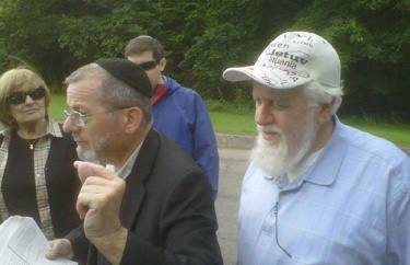Rabbi Safran listens to Dr. Leiman depict the destruction by the Soviets of the Vilna cemetery.