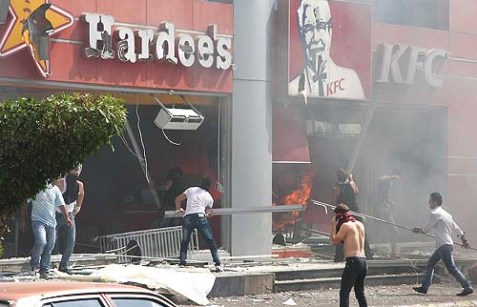 "Lebanese rioters ransacked Hardee's and KFC in Tripoli, in protest of ""Innocence of Muslims,"" September 14, 2012."