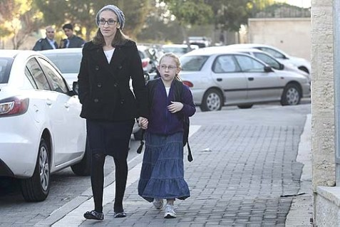 Eight-year-old Na'ama Margolis walking with her mother, Hadassa, on her way to school in Beit Shemesh, Dec 29, 2011.