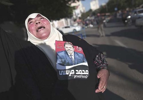 A Palestinian woman celebrating the victory of the Muslim Brotherhood's presidential candidate, Mohamed Morsi.