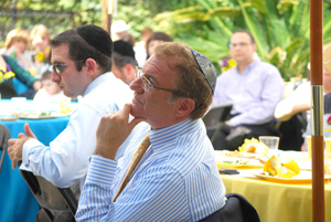 Puah brunch attendees. (Dr. Michael Feinman is in the foreground.)								(Photo credit: Arye D. Gordon)