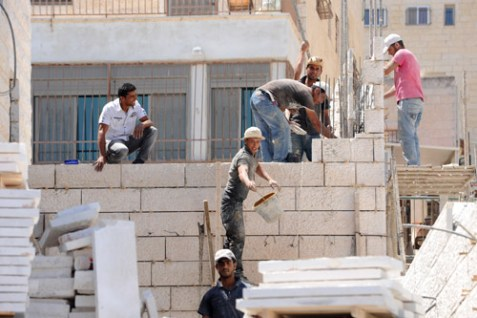 Arab construction workers are usually involved in building the homes for both Jews and Arabs.