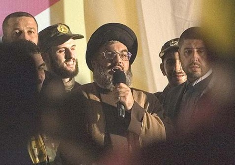 Hezbollah chief Hassan Nasrallah, center, in a rare public appearance.