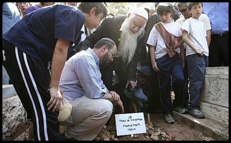 "Naftali and Elisha, brother and father of Avraham David Moses HY""D, one of the 8 students killed in a shooting attack at the Merkaz Harav yeshiva in Jerusalem, at his funeral, March 7, 2008."