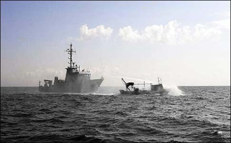 No more: an IDF gunboat sprays an Arab fishing boat with a water cannon to push it back within the 3-mile limit off the coast of Gaza.