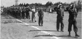 Lt. Yehuda Bielski leading his men on parade during the rebirth of the Jewish State.