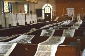 Sifrei Torah drying on the pews at F.R.E.E. of Brighton Beach/Hebrew Alliance.