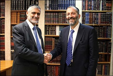 Shas Party Minister of Interior Eli Yishai (L) shaking hands with former Shas party chairman Aryeh Deri.