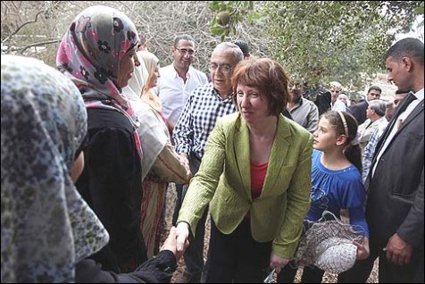 Palestinian Prime Minister Salam Fayyad and EU foreign policy chief Catherine Ashton help farmers in harvesting olives in the village of Ras Karkar near Ramallah, October 25, 2012.