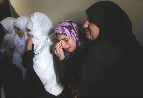 Relatives of terrorist Matter Abu al-Atta, who was killed in Israeli shelling on Saturday, mourn during his funeral in Gaza City.