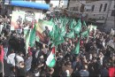 PA Arabs waving Hamas flags during a demonstration in Ramallah.