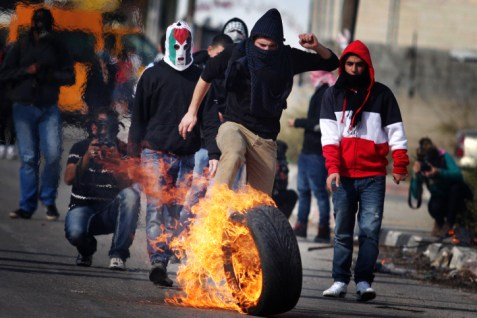 .Arab stone throwers clash with police.